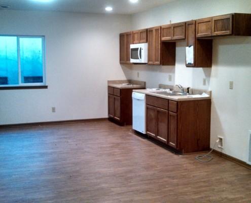 Kitchen in basement unit of 4-plex